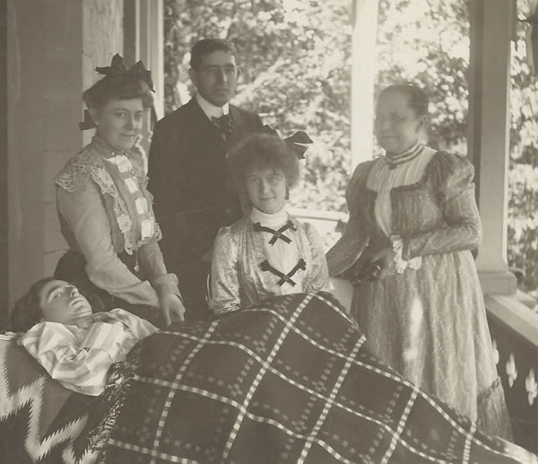 Will Adams with unidentified friends on the Adams family's back porch